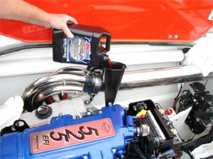 AMSOIL Dominator 15W-50 Racing Oil Poured into Mercury 525 Engine